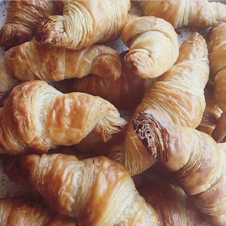 yellow basket baking vegan croissants